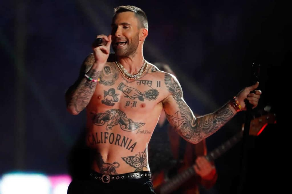 Adam Levine tattoos during Superbowl