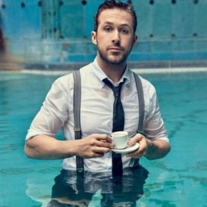 Ryan Gosling wet shirt drinking coffee in the pool