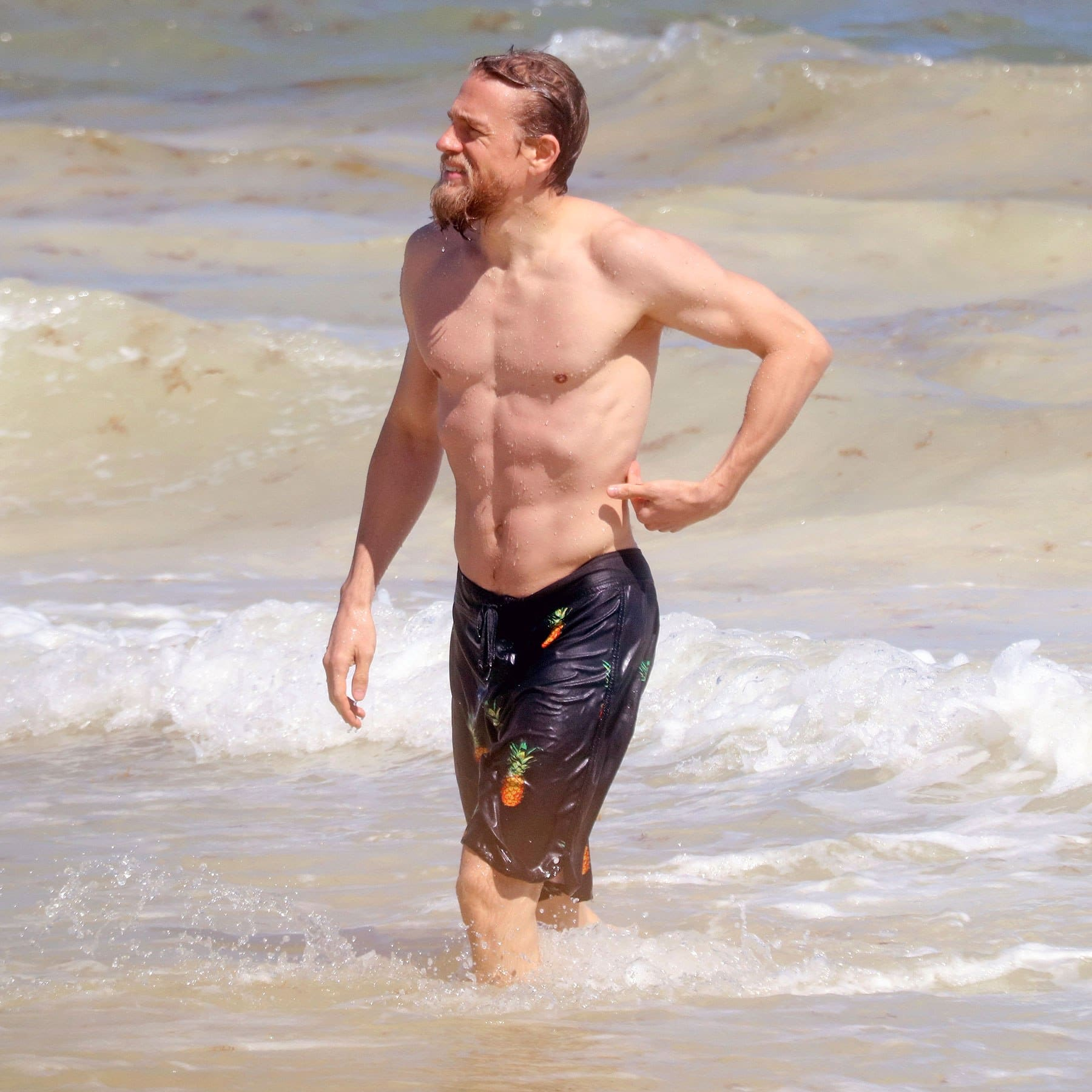 Charlie Hunnam shirtless and wet