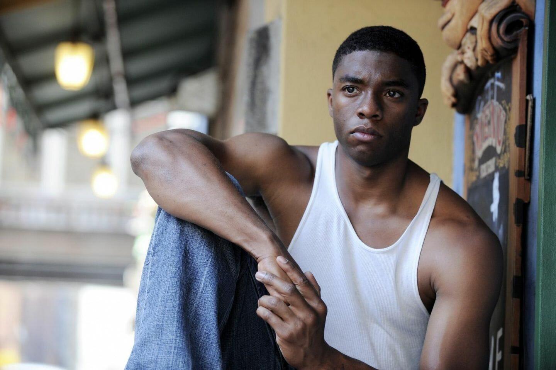 Chadwick Boseman biceps