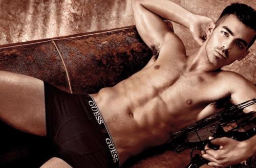 Joe Jonas modeling in dark underwear