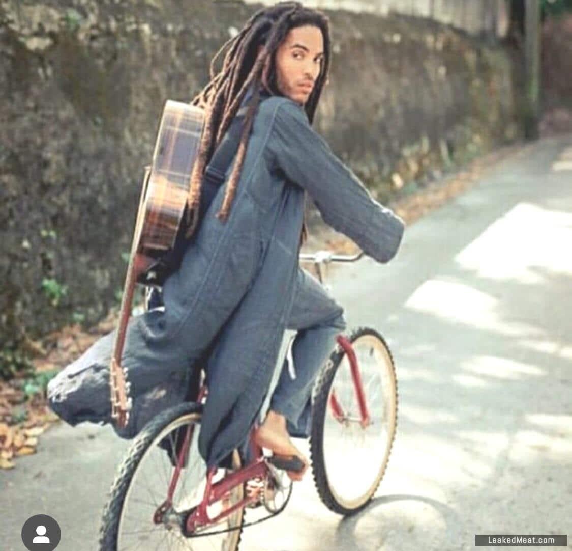 Lenny Kravitz long dreads on bike