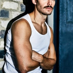 Julian Morris tank top stache